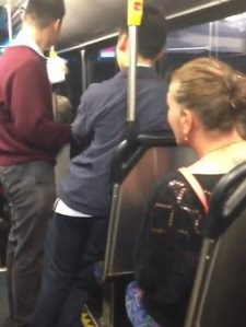 A Caucasian woman hurling abuse at an Asian schoolboy on public transport in Australia.